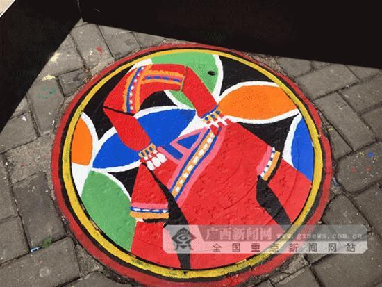 [动图视觉]南宁:巧手绘涂鸦 校园井盖成风景线